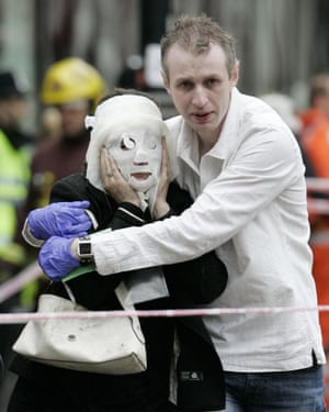 Former firefighter Paul Dadge helps injured tube passenger Davinia Turrell away from Edgware Road underground station, following the London terror attack on 7 July 2005.