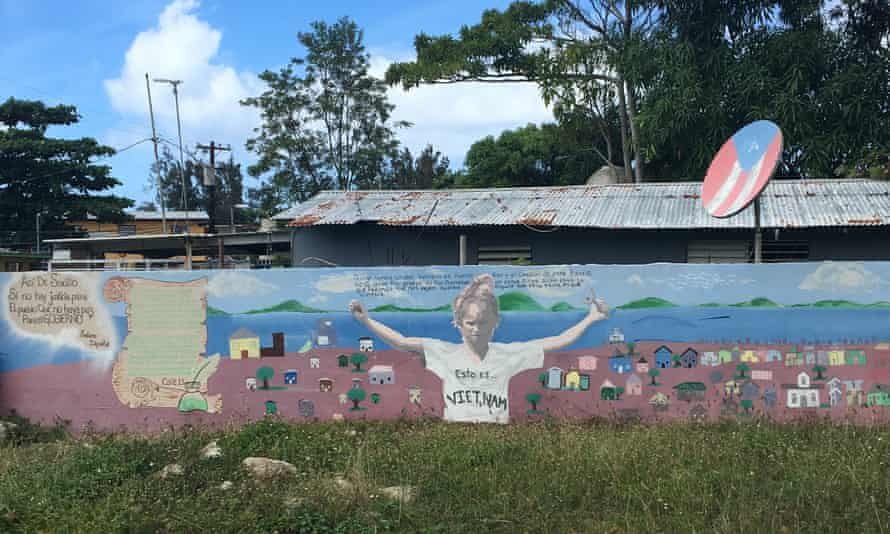 A mural local children have painted in a now vacant lot following an eviction in Vietnam.