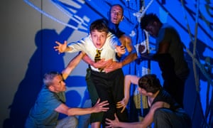Matthew Tennyson, centre, as 13-year-old Conor in Sally Cookson's production of A Monster Calls.