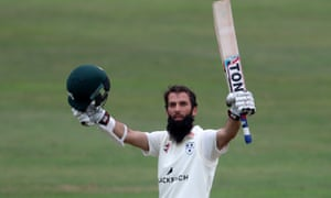 Worcestershire's Moeen Ali raises his bat after reaching his century against Yorkshire at Scarborough.