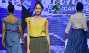 Models showcase a collection of Marks & Spencer's designs during a fashion show in Mumbai.