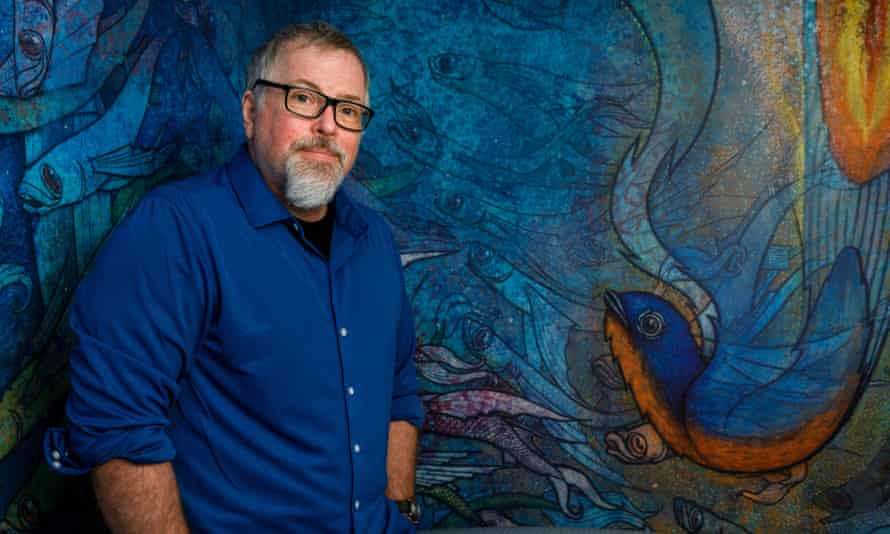VanderMeer in front of a mural in his home.