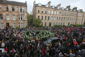An immigration enforcement team in Glasgow surrounded by protesters.