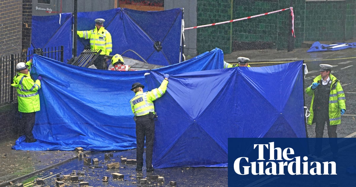 Three people die after car crashes into flats in west London