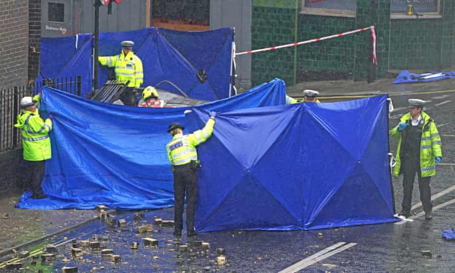 Police erect screens around the crash site