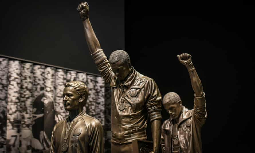 A statue depicting US athletes Tommie Smith and John Carlos as they raised gloved fists during the medal ceremony at the 1968 Olympics is housed at the Smithsonian Institute's National Museum of African American History & Culture.