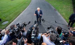 Trump speaks to reporters on Friday.