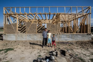 Akmal, 30, also from Batken, stands in front of his new house, which he is building while raising his four children – and two of his neighbours'. Akmal's wife is currently working as a waitress in Moscow<br>