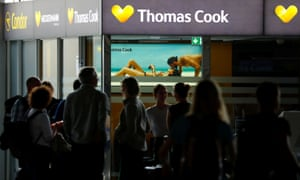 A closed service counter of travel agent Thomas Cook and airline Condor at the airport in Frankfurt, Germany, today.