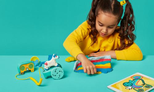 A child plays with toys