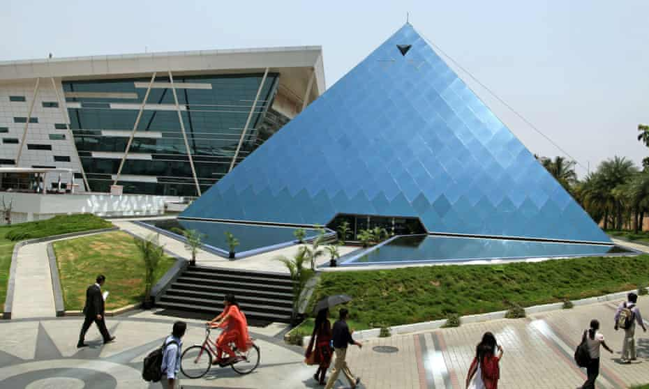 People walk through Infosys Technologies headquarters in Bangalore, India.