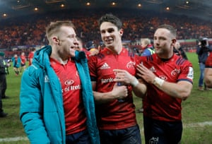 Joey Carbery (centre) is congratulated by Rory Scannell (left) and Alby Mathewson (right) after his kick won the match for Munster against Exeter at Thomond Park.