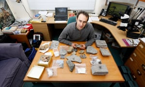 steve brusatte at the finds table in his office