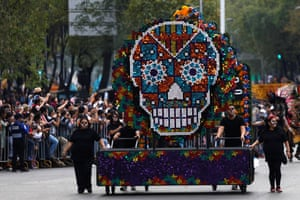 A float with a skull figure participates in a procession to commemorate Day of the Dead in Mexico City,