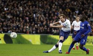 Tottenham's Harry Kane thwacks the ball goalward.