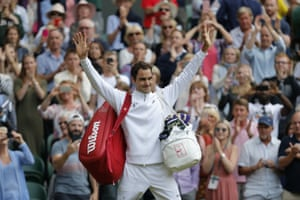 Roger Federer soaks up the applause as he leaves Centre Court.