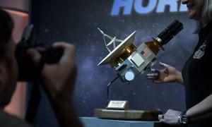 A model of the New Horizons probe at the Johns Hopkins University applied physics laboratory.