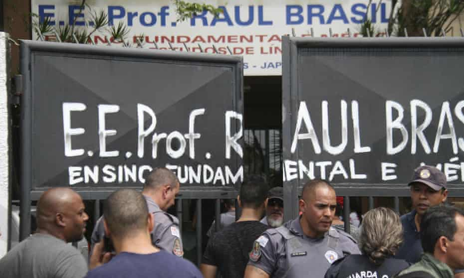 Police officers guard the entrance of the Raul Brasil school. About 1,000 children attend the school, police said.