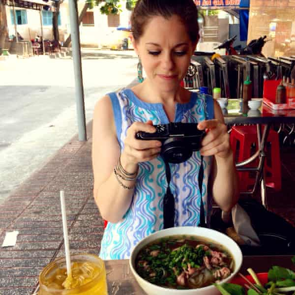 The author photographing her bowl of Pho-To.