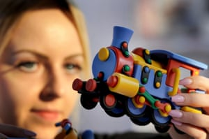 Julia Schafer, of Mic-O-Mic, adjusts a model of a train