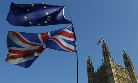 Union Jack and EU flags fly outside parliament