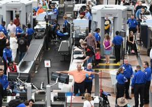 Travellers passing through security at Denver airport.