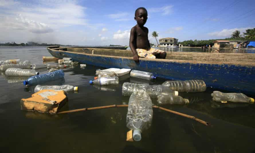 Plastic bottles floating on the Ebrie lagoon in the city of Abidjan, Ivory Coast