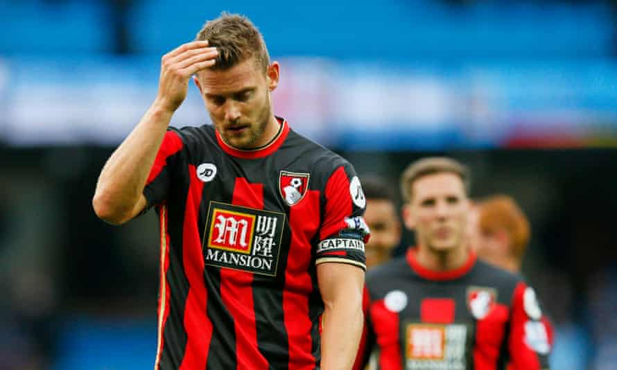 Bournemouth's Simon Francis walks off the pitch after his side's 5-1 defeat to Manchester City.