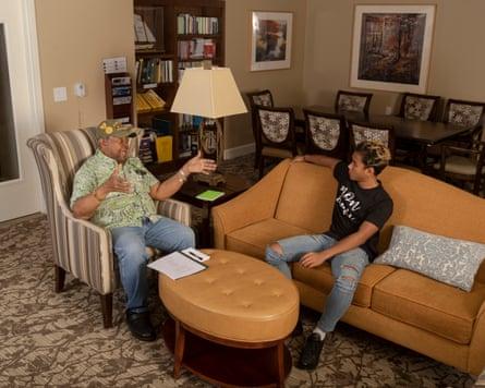 Marck Rakotoson, right, visits with Carlos Watson at the BridgePoint senior living facility in Los Altos, California.