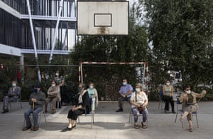 Social distancing and wearing protective face masks, people wait to receive their second dose of the Sinovac Covid-19 vaccine at the Carmela Carvajal public school in Santiago, Chile, Wednesday, on 3 March, 2021.
