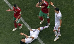 Portugal defender Pepe lies prone after feigning contact from Morocco defender Mehdi Benatia in the group stage game in Moscow.