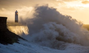 Waves batter the lighthouse at Porthcawl in Wales.