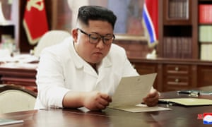 Kim Jong-un reads a letter from Donald Trump.