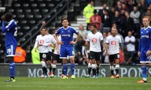 Dejected Brentford players during the recent defeat at Derby.