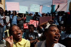 A theater troupe of university students perform as grade school students recite a lesson on Haiti's constitution and government during a protest calling for President Jovenel Moïse to resign so that schools can reopen in Port-au-Prince, Haiti, on 21 October 2019