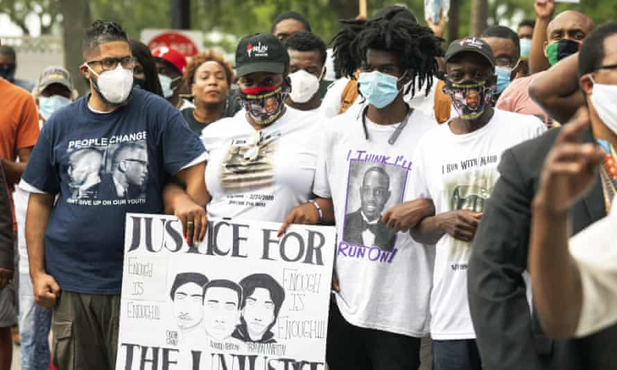 Family members and supporters protest against the authorities' handling of Arbery's death at a rally this month.