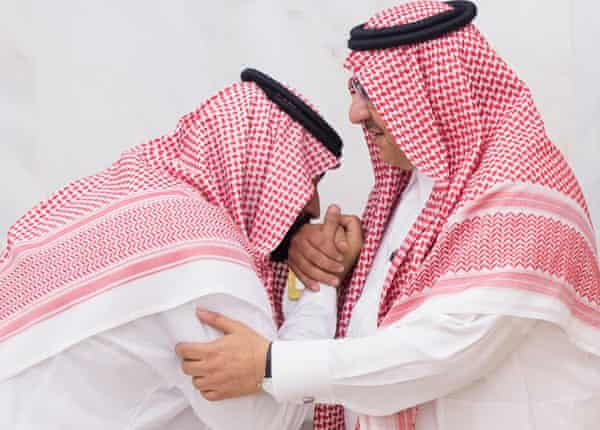 Mohammed bin Salman, newly appointed crown prince, kisses Mohammed bin Nayef's hand.