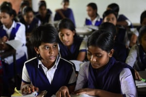 """High school footballer Tahura Khatun, left, known as """"Kolsindur Messi"""", in a lesson with classmates. More than a dozen of Kolsindur's players have already played on the national girls' team, among them 12-year-old Tahura"""