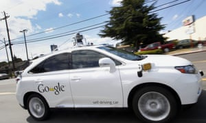 In this 13 May 2015 photo, Google's self-driving Lexus car drives along street during a demonstration at Google campus in Mountain View, California.