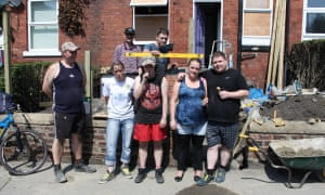 a homeless family works with Canopy Housing volunteers and staff to renovate a long term empty house