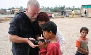 Kevin Ryan, seen here in Kosovo in 2009, was a dedicated photographer, and often used photography in his work