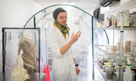 Ashley Granter, lead mycologist, holds a liquid suspension of mycelium in the Biohm research lab in Shepherds Bush, west London.
