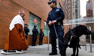 Police officers outside the Islamic Cultural Center of New York as people arrive for Friday prayers