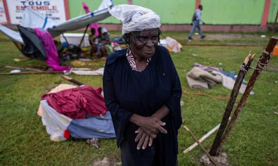 A woman looks on in a makeshift camp in Les Cayes, Haiti.