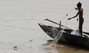 Fishing is a source of livelihood for Cambodian people along the Mekong River<br>epa06052041 A Cambodian man works on his fishing boat on the Mekong River in Phnom Penh, Cambodia, 27 June 2017. Fishing is second only to rice cultivation as a source of livelihood for Cambodian people along the Mekong River and Tonle Sap Lake, supporting the lives of whole communities. Tonle Sap Lake is one of the largest freshwater lakes in Southeast Asia and provides some 350,000 to 400,000 tons of fish for the people's consumption and commerce. EPA/MAK REMISSA