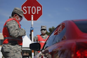 Members of the Nevada Air National Guard work at a drive-thru coronavirus testing site Tuesday, April 28, 2020, in Las Vegas.