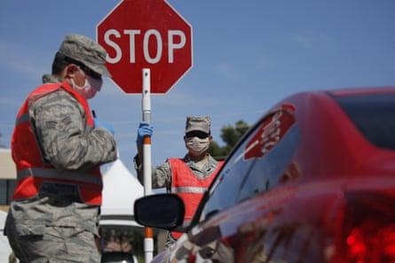 Members of the Nevada Air National Guard work at a drive-thru coronavirus testing site Tuesday, April 28, 2020, in Las Vegas.