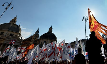 People hold Lega Nord flags as they take part in a rally held by Northern League party leader Matteo Salvini in Rome