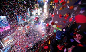 Confetti is dropped on revelers at midnight during New Year celebrations in Times Square, New York