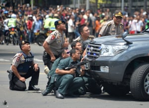 Jakarta, Indonesia: Police take up positions behind a vehicle